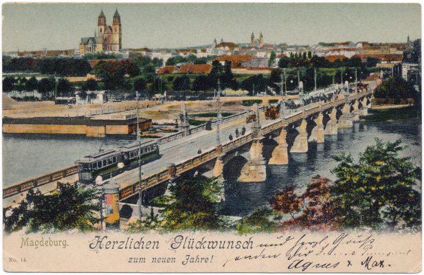 """Eine historische Ansichtskarte der """"langen Brücke"""" zeigt eine Elektrische mit Blick Richtung Dom um 1912. (AK Louis Koch, Sammlung: Ralf Kozica)"""